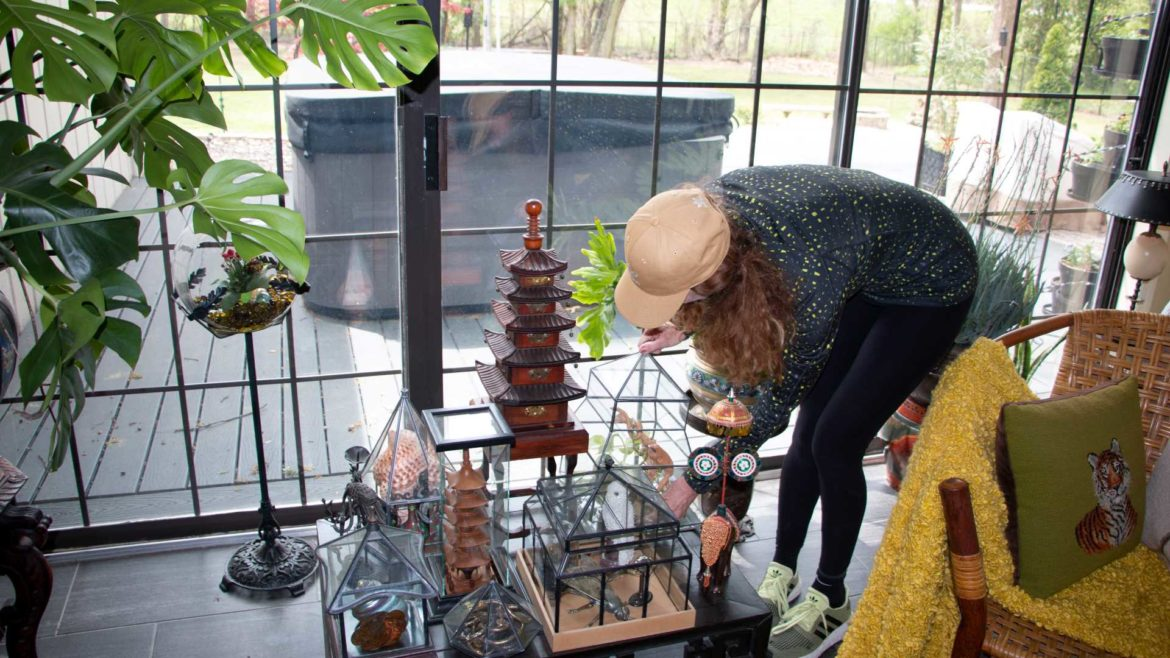 Stephanie Watts adjusts her decorative display in the family's sunroom.