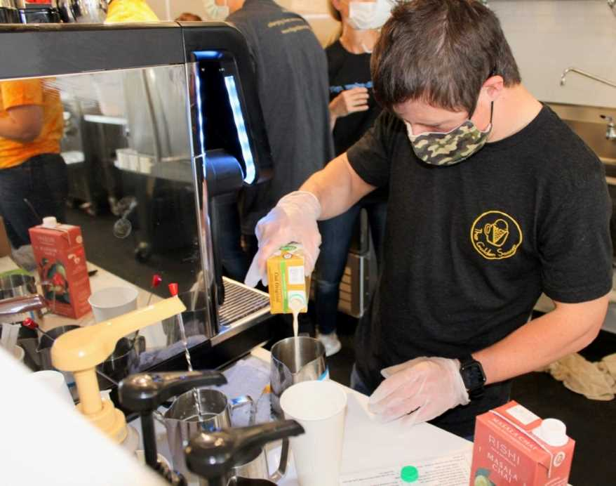 Patrick Chapman enjoys making coffee drinks for customers at The Golden Scoop.