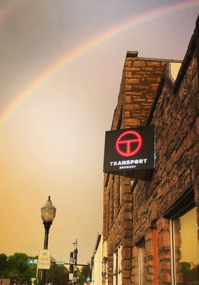 A rainbow over Transport Brewery in Shawnee