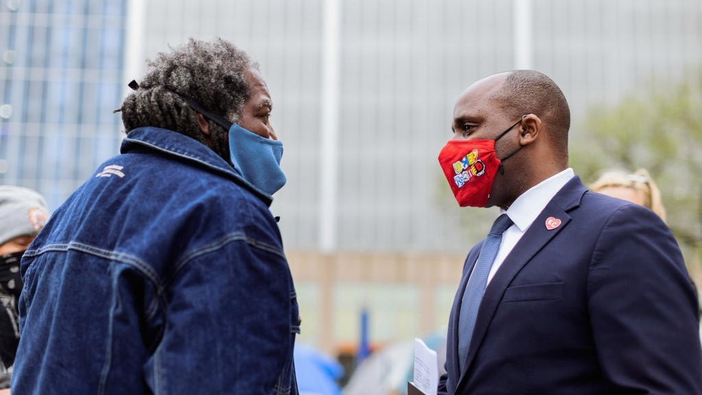 James Qadhafi Shelby, leader of the Kansas City Homeless Union, talks with Kansas City Mayor Quinton Lucas on April 7 in front of City Hall following another meeting to discuss the Homeless Union's demands.