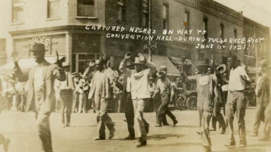 A picture postcard issued after the 1921 Tulsa race massacre depicted Black residents being led to the city's convention hall.