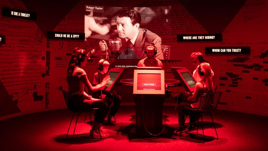 """In a room devoted to the """"Red Scare"""" of the Cold War, guests will be bathed in red light as they participate in a """"Loyalty Review Board"""" role-playing game at the same time film footage will depict figures from the Hollywood entertainment industry - such as actor Robert Taylor - testifying before the House Un-American Activities Committee."""