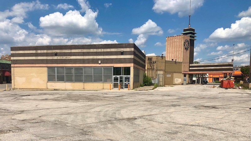 The apartment building planned by Lux Living would replace the parking lot behind the Katz Drugstore.