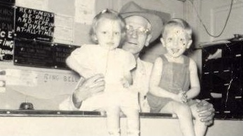 Della Reynolds (left) poses for a photo at The Dean Hotel front desk with her father Joseph Hagerty (center) and brother George (right) (Courtesy | Della Reynolds)