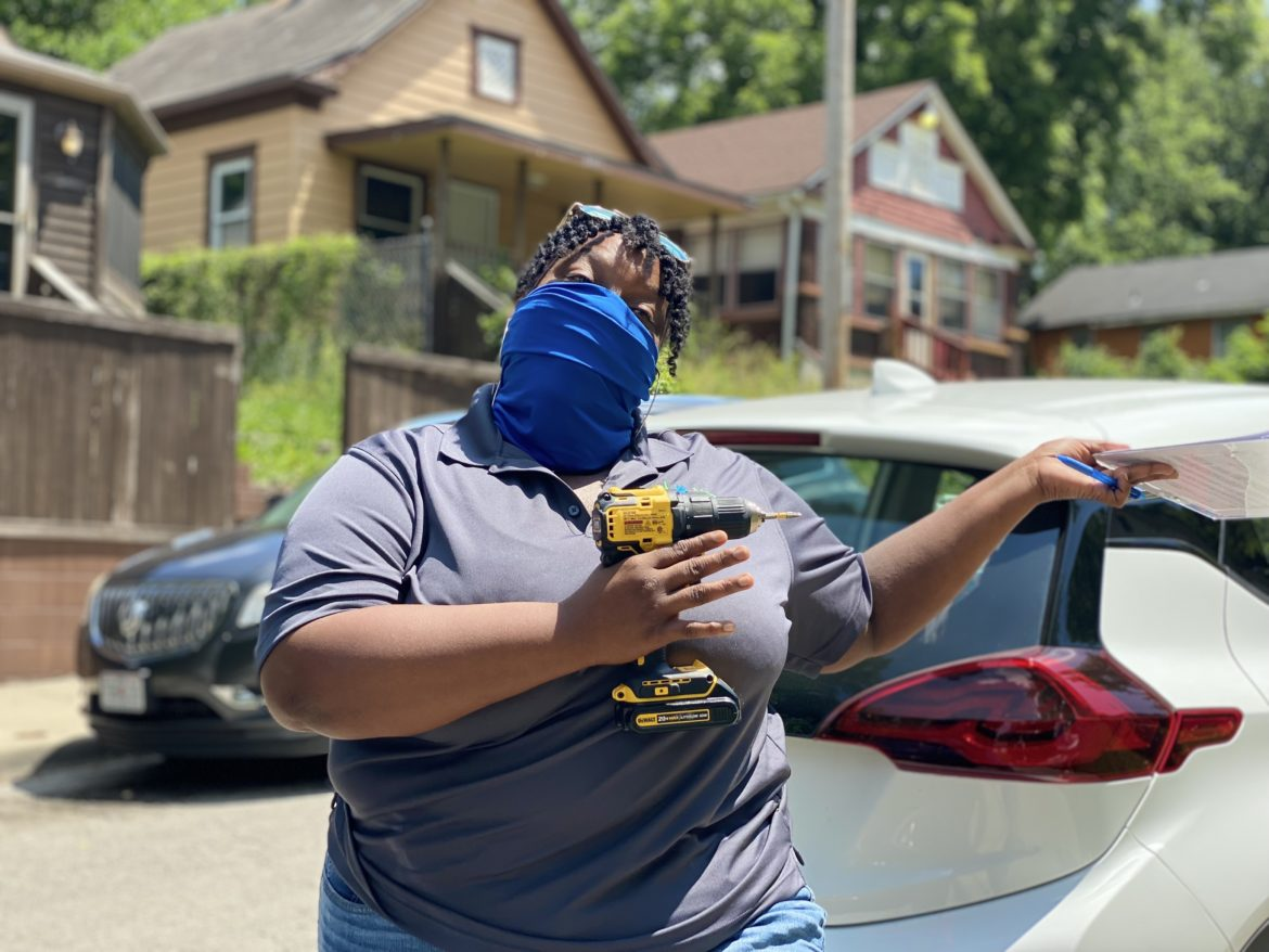 DeJuan Carpenter, code enforcement officer with the Land Bank of Kansas City, poses with her power drill.