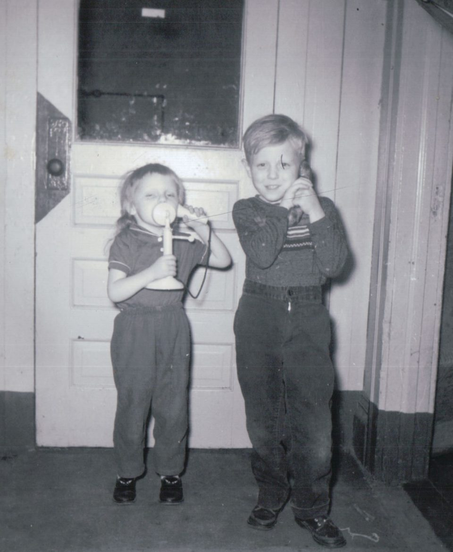 Della and George play with hotel phones. (Courtesy | Della Reynolds)
