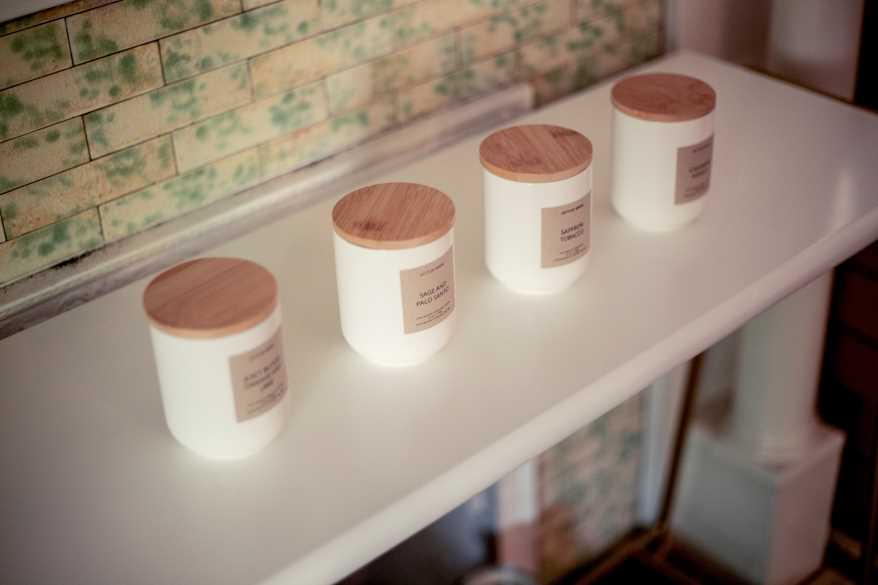 Candles manufactured and sold by Gifts by Birdie, the candle-making business launched by Birdie Hansen.