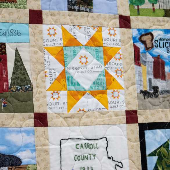 To make the quilt even, seven additional blocks were added with Missouri themes. Pictured here is a block by Courtenay Hughes for Missouri Star Quilt Co.