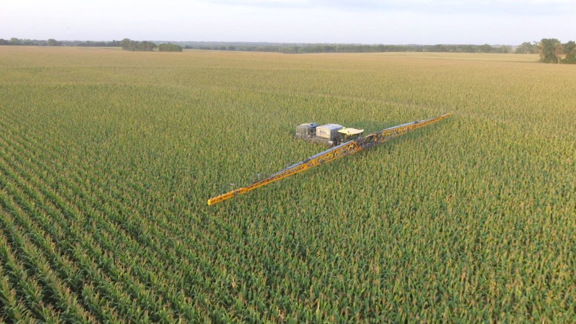Aerial view of Nick Guetterman's corn field as he seeds cover crop between the rows of corn.