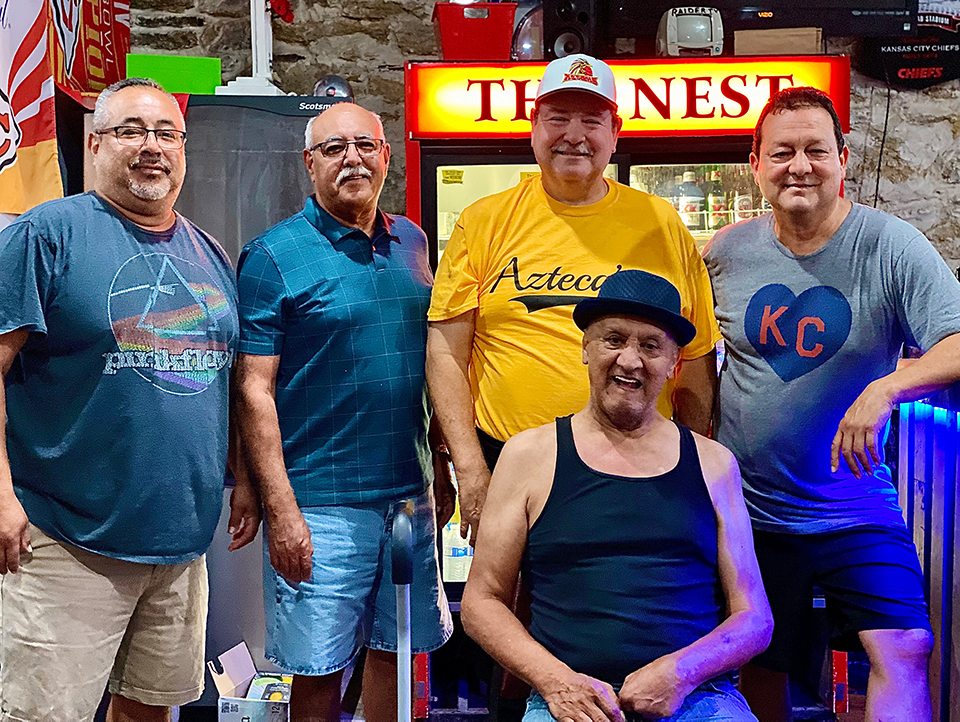 """The former teammates and friends now spend time at The Eagles Nest. They told me if you want to find other fellow Latinos, """"follow the railroad tracks. Standing: L-R, Javier Escobar, Mario Escobar, Anthony Scott Gomez, Luis Madrigal Sitting: Paul """"Paulie"""" Hernandez."""
