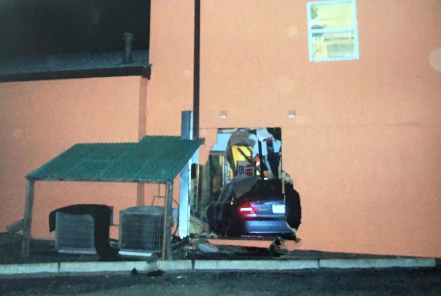 A car that crashed through back wall of House of Sight and Sound.