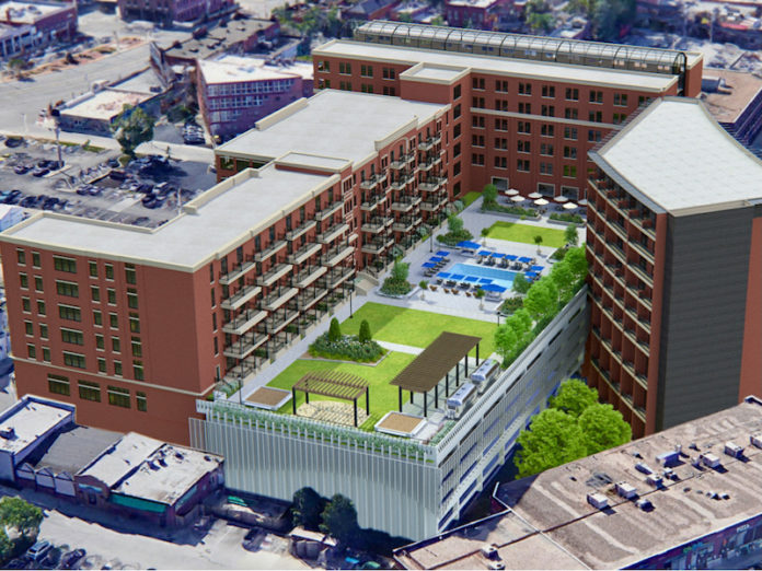 A view looking southeast of the proposed Westport Terrace at Manor Square project, a rooftop park is proposed for the existing garage.