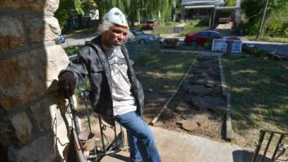 Kenneth Jenkins stands on his front porch along Montgall Avenue where he's been battling neighbors and city code enforcers.