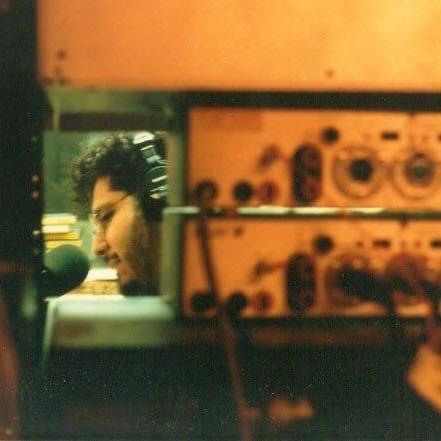 Velasquez, just barely seen through a window in a Lazer radio studio.